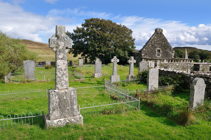 Graveyard at St Mary's, Dunvegan, Skye Ancient Celtic Cross Cemetery Cloud Cloud - Sky Dunvegan Grass Graveyard Highlands History Monument No People Old Scotland Sky Skye The Past Tombstone Tourism Tree