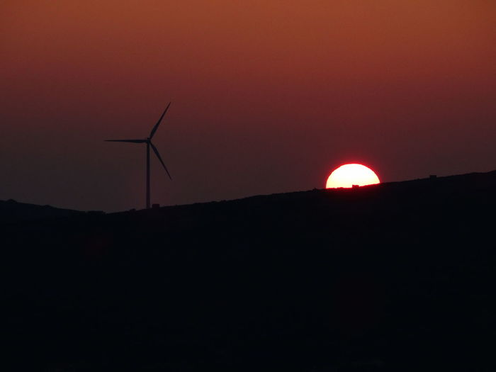 Alternative Energy Beauty In Nature Environmental Conservation Fuel And Power Generation Nature No People Orange Color Outdoors Renewable Energy Scenics Silhouette Sky Sun Sunset Tranquility Wind Power Wind Turbine Windmill