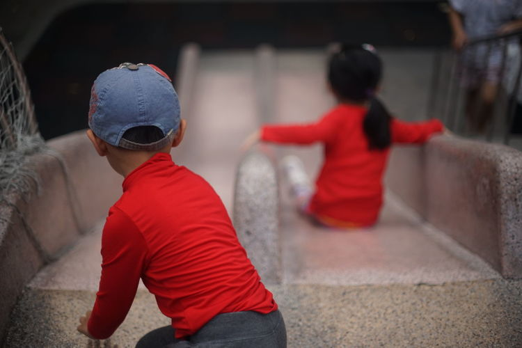 High Angle View Of Children Playing On Slide In Park