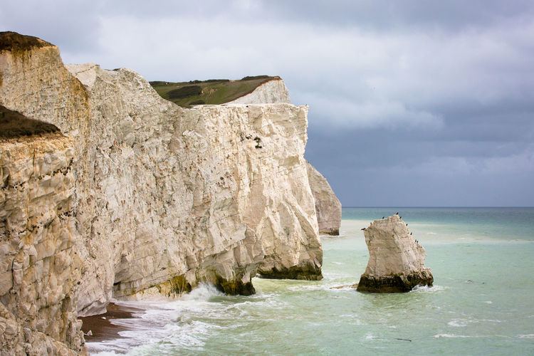 United Kingdom Beach Beauty In Nature Cliff Cliffside Cloud - Sky Day Eroded Horizon Horizon Over Water Land Nature No People Outdoors Rock Rock - Object Rock Formation Rocky Coastline Scenics - Nature Sea Sky Solid Tranquil Scene Water White Cliffs