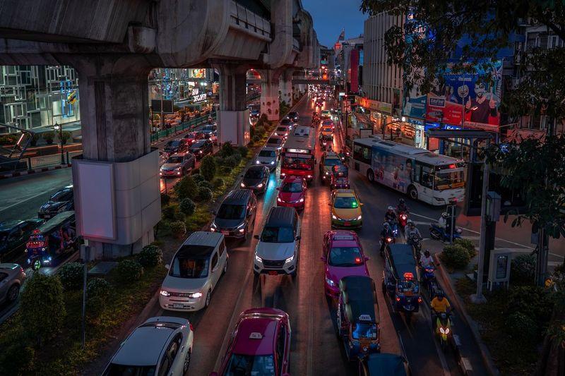 Cities At Night Busy City Bangkok Transportation City Architecture Illuminated Mode Of Transportation Car Motor Vehicle Street Night Road Land Vehicle Traffic High Angle View City Street Outdoors