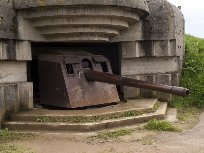 Gun in placement Omaha Beach Normandy France Architecture Building Exterior Built Structure Cannon Day Fort Gun Historic History Memories No People Old Omaha Beach Outdoors Shore Battery Stone Material The Past Weathered