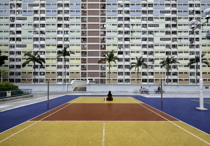 Architecture Building Exterior Built Structure Chinese Building City Colorful Building Colors Colourful Buildings Court Day Habitat Hong Kong Architecture Hong Kong Bedtown Hong Kong Building Hong Kong Estate Hong Kong Housing Housing Lifestyles One Person Outdoors People Real People Sport Tennis