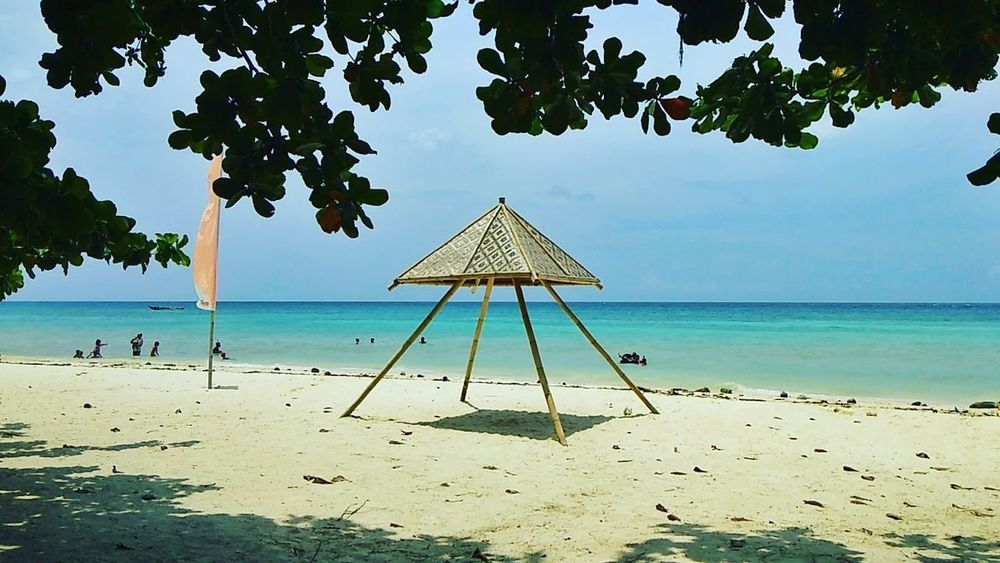 Sea Sand Ocean Beach Tree Water Sea Beach Sand Sky Horizon Over Water Beach Umbrella Sunshade Umbrella Shelter Under Lifeguard Hut Lifeguard  Turquoise Colored Seascape Thatched Roof Shore