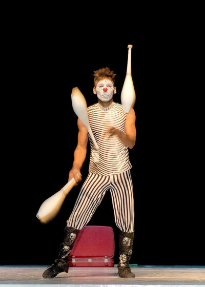 MALABARISTA Pabellon Show Arms Raised Arts Culture And Entertainment Black Background Costume Csl Front View Full Length Hairstyle Human Arm Indoors  One Person Performance Stage Stage - Performance Space Standing Striped Studio Shot Young Adult