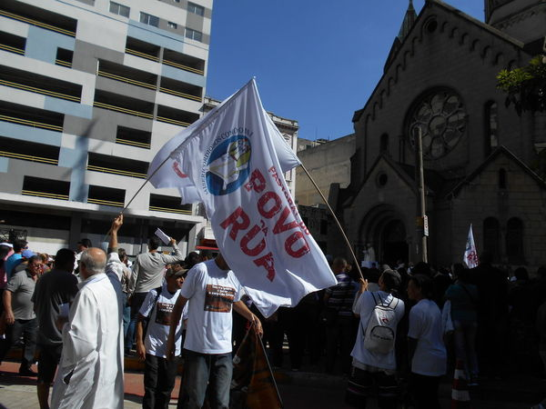 "Man of Faith participates in the Corpus Christi outdoor Mass and demonstration ""Pastoral do Povo da Rua"" held at the Santa Ifigênia church in downtown São Paulo on May 31, 2018. In Brazil, Corpus Christi is a Catholic celebration commemorating the Eucharist (the Eucharist is the symbolic presence of the Body of Christ in the consecrated host). The Corpus Christi holiday does not happen on the same day every year. Corpus Christi Corpus Christi Holiday Igreja De Santa Ifigênia May 31 May 31, 2018 Santa Ifigenia Viaduct Susan A. Case Sabir Unretouched Photography Belief Catholic Faith Catholic Religion Downtown São Paulo Man Of Faith Outdoor Mass Outdoor Congregation Real People Reinforcement Religious Holiday Santa Ifigenia Solidarity Street Photography Sunny Day Togetheness Urban Photography"