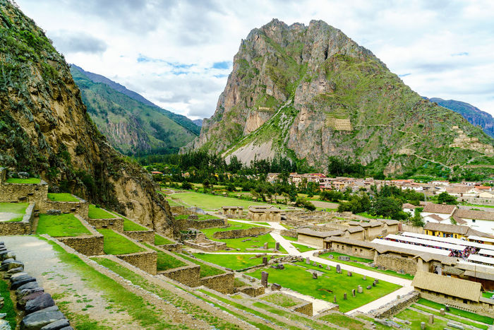 View of inca archaeological site with the Sun Temple on the mountain at Ollantaytambo in Peru Ancient Inca Ollantaytambo - Peru Trees View Aerial View Archeological Site Clouds Famous Place Forest History Mountain Old Scenics Sun Temple Travel Destinations Valley Village