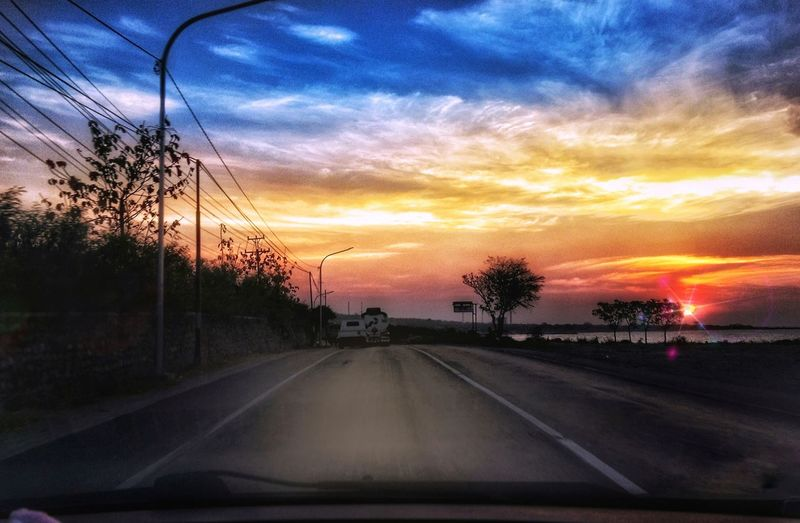 is on the way to meet the sunset Sunset The Way Forward Transportation Cloud - Sky Sky Road Car Scenics Land Vehicle Nature Beauty In Nature Outdoors
