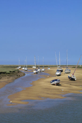 Tides Out Blue Clear Sky Day Landscape Mast Mode Of Transport Moored Nautical Vessel No People Outdoors Sailboat Sand Scenics Sea Sky Tranquil Scene Transportation Water