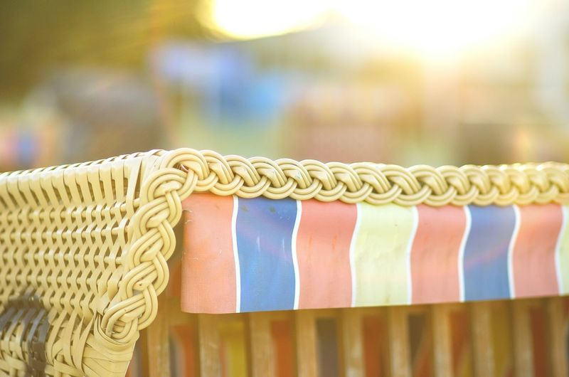 Close-up of hooded beach chair during sunny day