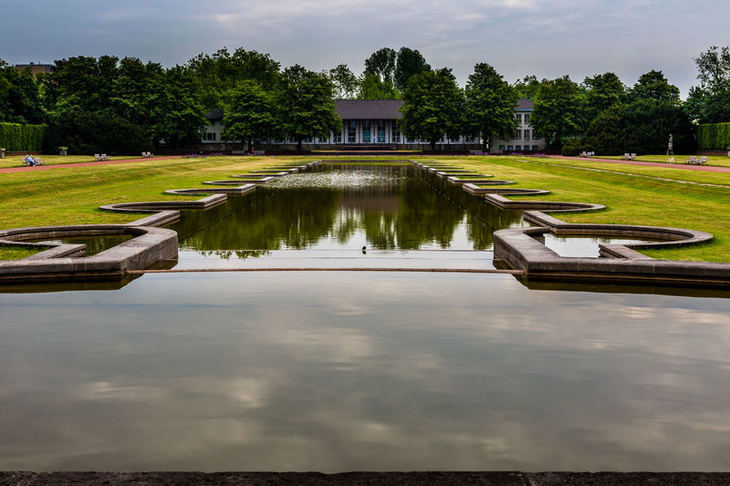 Architecture Beauty In Nature Cloud Cloud - Sky Cloudy Grass Green Color Nature Nordpark Nordpark Düsseldorf Outdoors Park Reflection Scenics Sky Standing Water Tranquil Scene Tranquility Travel Destinations Tree Water