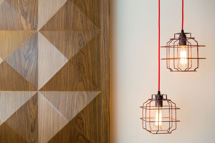 Illuminated Pendant Lights Against Wall