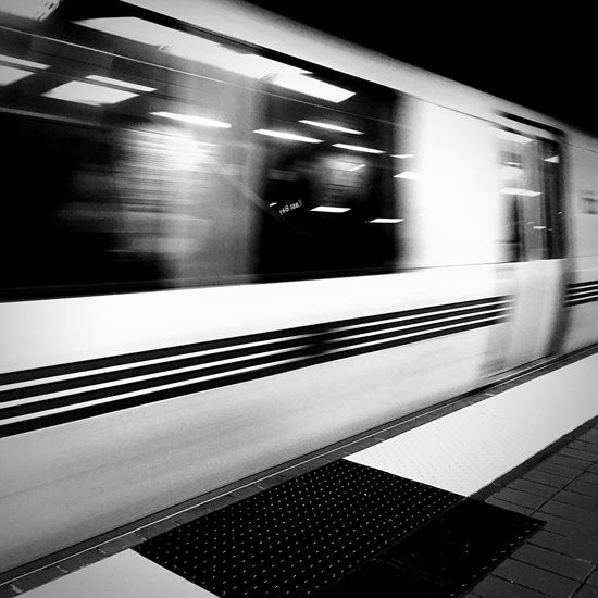 BART train back to the Airport on Public Transportation . Vroom indeed in Black And White