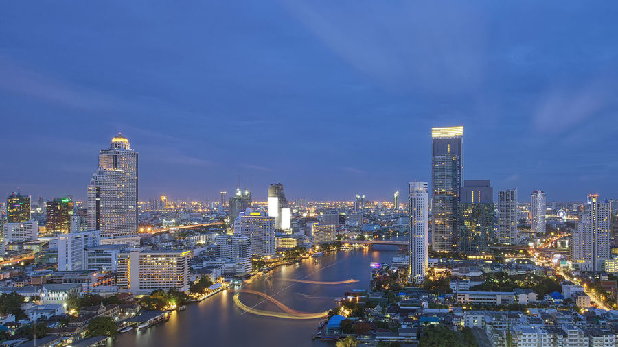 Skyscrapers at Chao Phraya River, Bangkok, Thailand Bangkok Cityscape Skyscrapers Thailand Architecture Building Exterior Buildings Built Structure Chao Praya River City Cityscape Downtown District Illuminated Modern Night No People Outdoors Road Sky Skyscraper Travel Destinations Urban Skyline