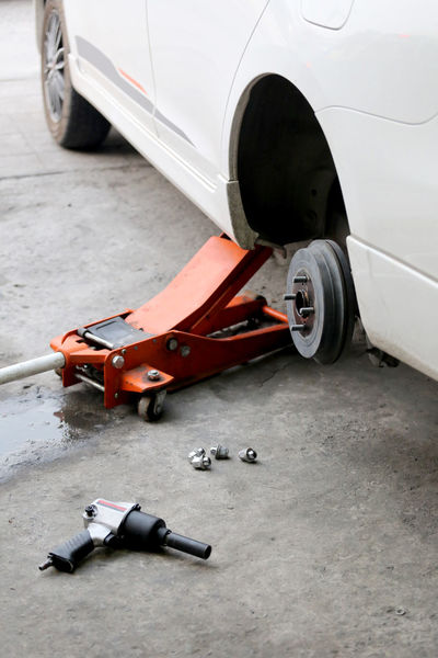 mechanic repaired wheeled vehicles in the garage. Transportation Mode Of Transportation Car Motor Vehicle High Angle View Day Land Vehicle No People Metal Still Life City Wheel Street Outdoors Road Close-up Stationary Tire Flooring Mechanic Mechanical Repaired Wheeled Vehicles Garage