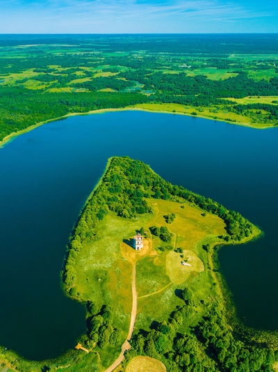 Holy Trinity Church on the Chereyskoe lake, Vitebsk Region, Belarus Belarus Church Aerial View Beauty In Nature Day Environment Flying Green Color High Angle View Land Landscape Nature No People Non-urban Scene Outdoors Plant Scenics - Nature Sky Tranquil Scene Tranquility Tree Water