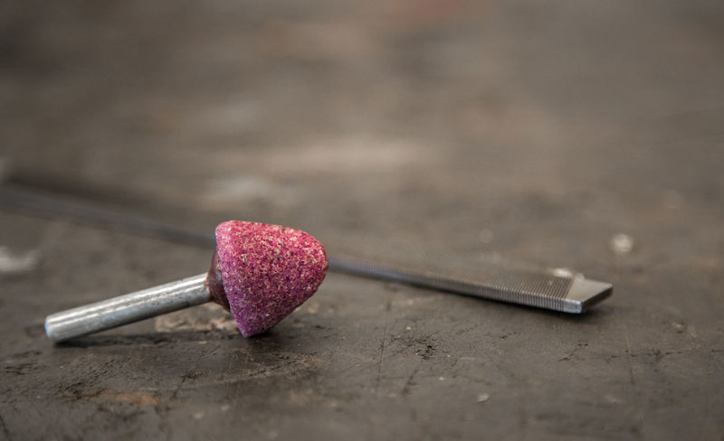 Abrasive Close-up Day Food Food And Drink Hand Tool High Angle View Indoors  Matchstick Metal No People Pink Color Red Selective Focus Sharp Still Life Table Tool Two Objects Wood - Material Work Tool