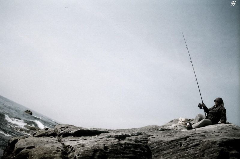 Beach Blue Canon AE-1 Fisherman Fishing Fishing Rod Inclined Horizon Look Twice Rock Water And Sky Pivotal Ideas Perspectives On Nature