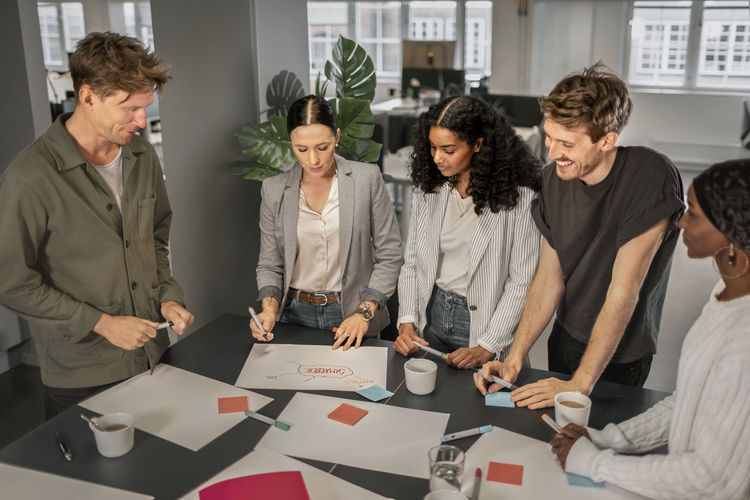Group of people working on table