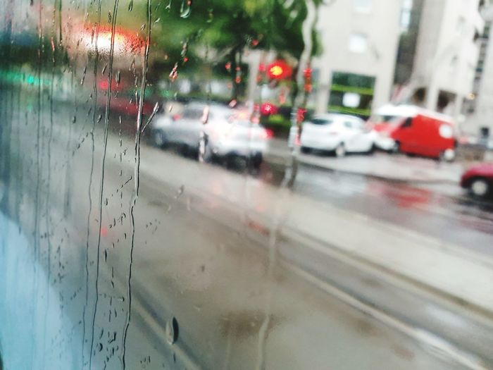 Land Vehicle Car Road Wet City Drop Weather Rain Close-up RainDrop Traffic Jam Dew Rush Hour Vehicle Light Car Point Of View Traffic High Street Torrential Rain Looking Through Window Windshield Multiple Lane Highway Road Intersection