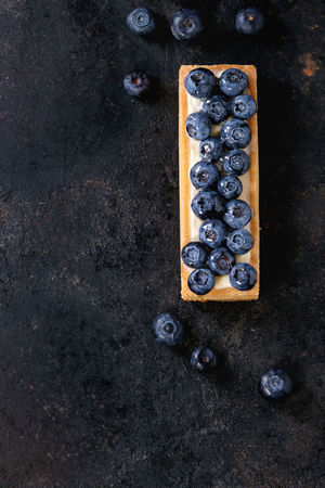 Square Lemon tartlet with fresh blueberries over black background. Top view. With space for text Berries Black Background Copy Space Desserts Lemon Tarte Shortbread Berry Tartlet Blackberry Blueberry Blueberry Tart Directly Above Food Lemon Zest Pastry Shortbread Tartlet Sweet Food Tart - Dessert Tartlet Texture Top View Of Food