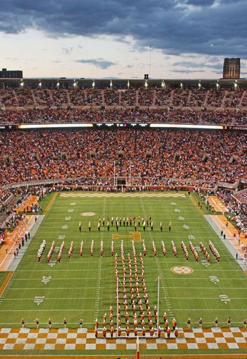 University of Tennessee Pride of the Southland Marching Band creating Power-T formation during pregame. Checkerboard Crowd Football Green Color Knoxville Tennessee Large Group Of People Marching Band Neyland Stadium Playing Field Pregame Spectator Tennessee Pride Of The Southland Marching Band University Of Tennessee