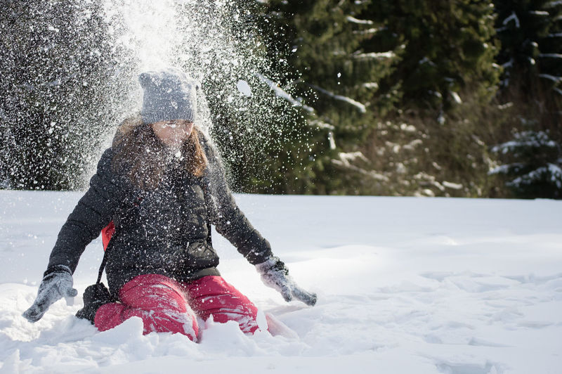 Girl Playing In Snow In Snow