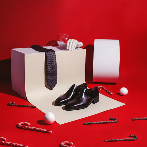 Close-up of objects on table against red background