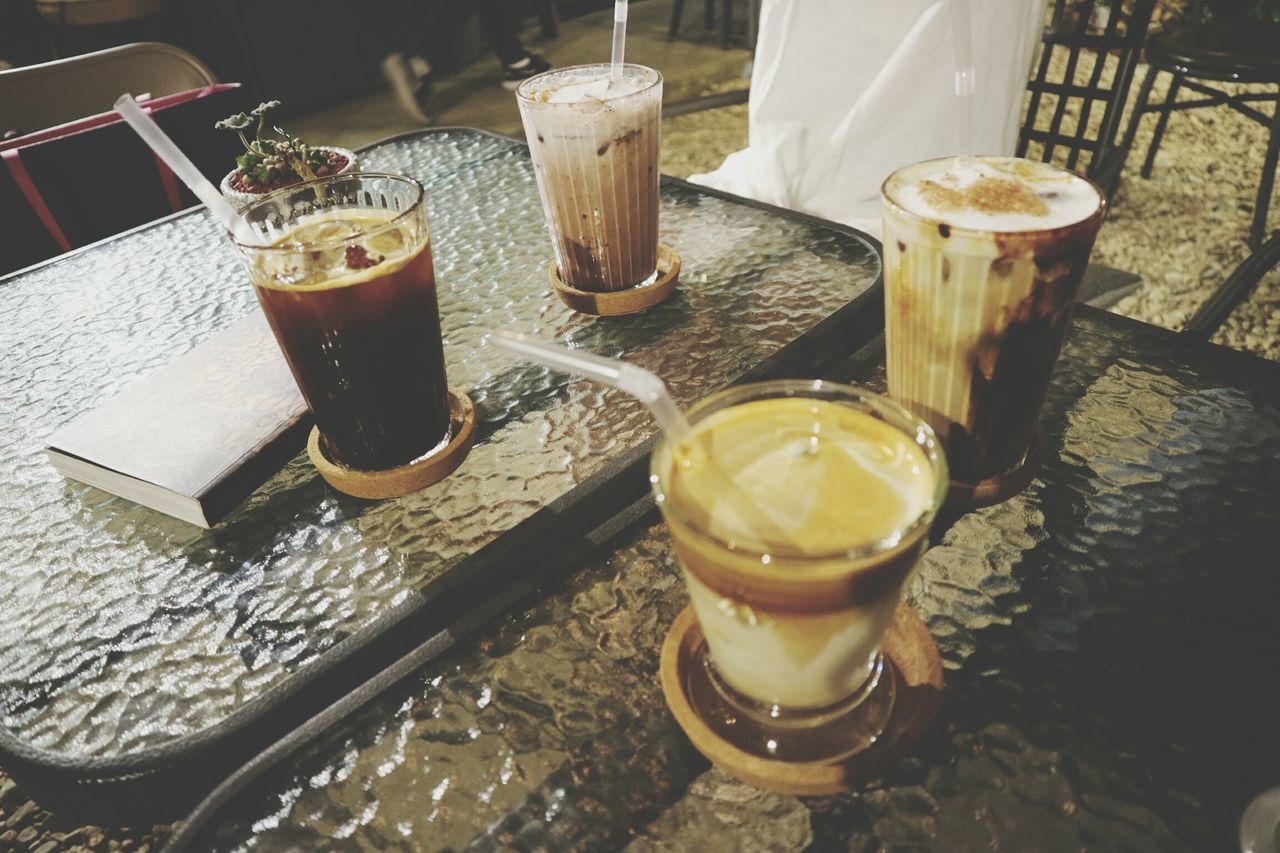 drink, drinking glass, refreshment, food and drink, table, drinking straw, coffee - drink, alcohol, indoors, freshness, no people, iced coffee, high angle view, shot glass, cafe, ice cube, day, cold temperature, frothy drink, close-up, liqueur