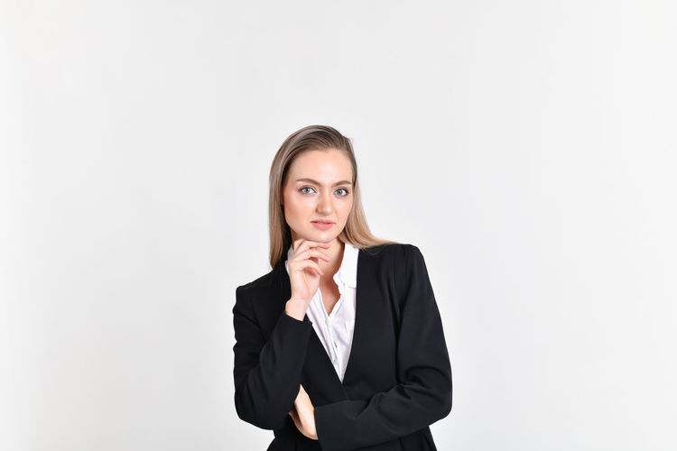 Portrait Of Businesswoman Standing Against White Background