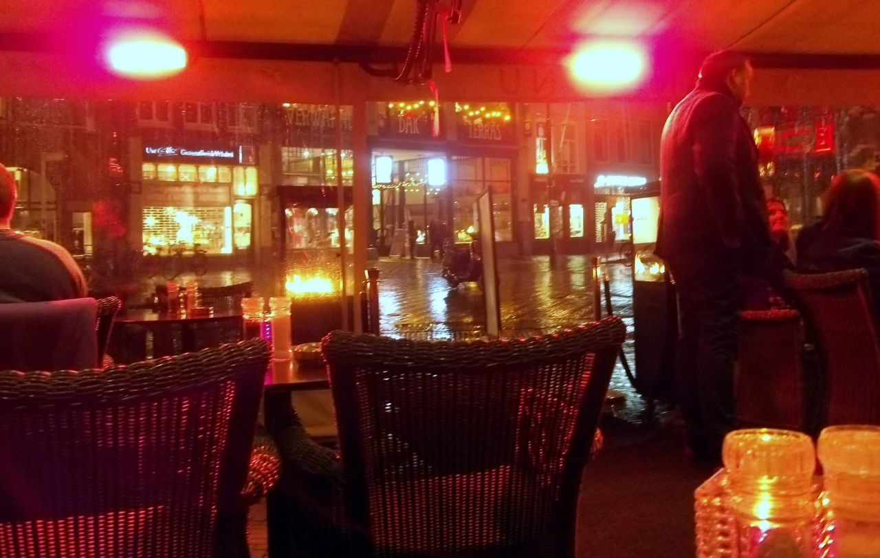 illuminated, night, restaurant, table, food and drink, chair, indoors, food, real people, drink, one person, people