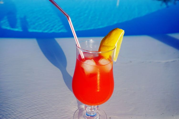 High angle view of drink against swimming pool