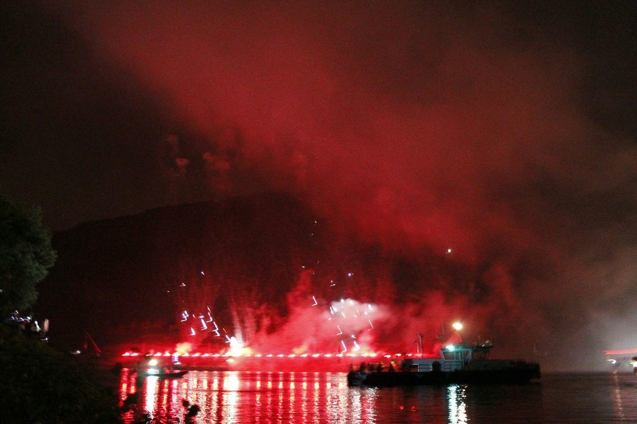 Firework Display Above Sea At Night