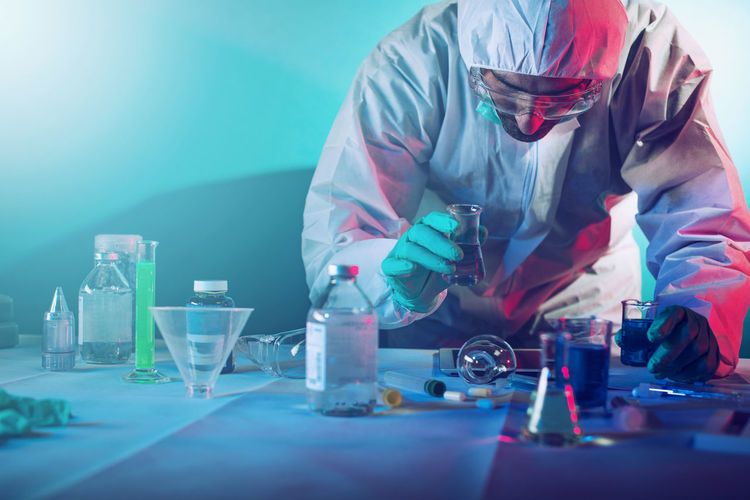 Man in protective workwear working in lab