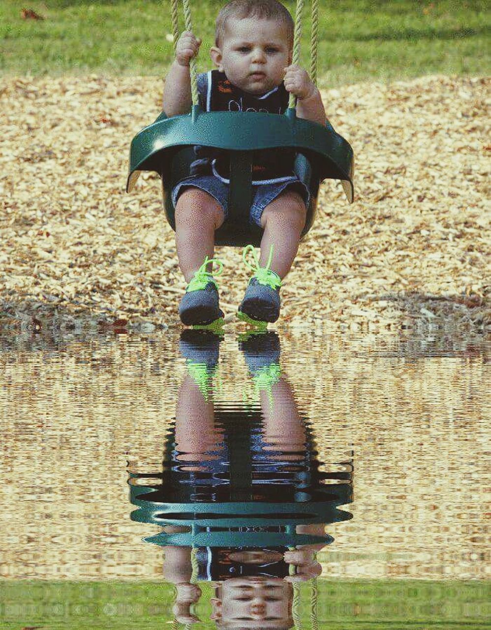 childhood, one person, full length, front view, outdoors, boys, day, males, portrait, smiling, child, playing, happiness, real people, puddle, grass, children only, one boy only, water, nature, people