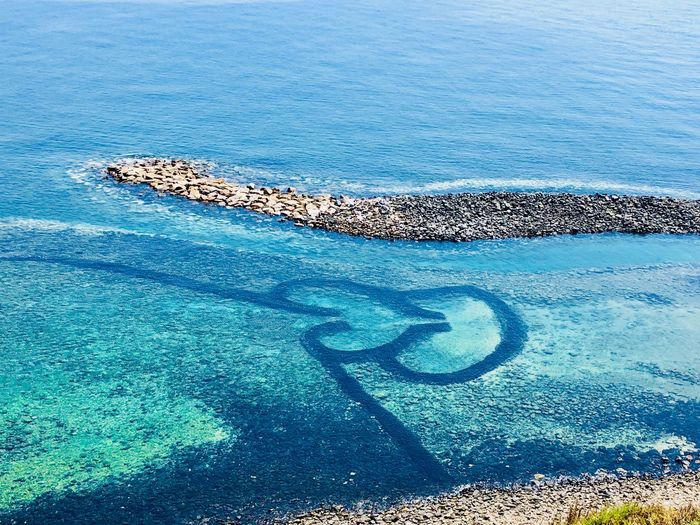Twin-hearts Stone Weir Stone Wall Twin Hearted Water Sea Nature Beauty In Nature Day No People Scenics - Nature Outdoors High Angle View Blue Tranquil Scene Tranquility Land