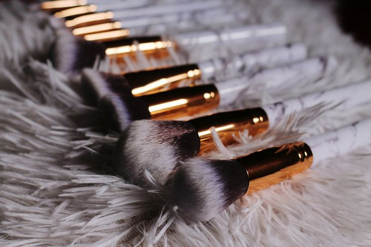 Close-Up Of Brushes On Table