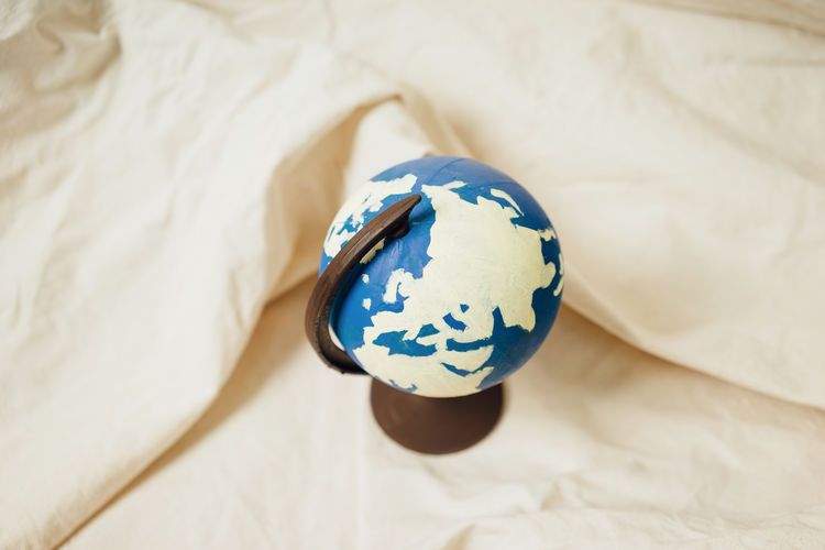 High angle view of globe on bed