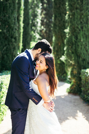 Newlywed Couple Romancing While Standing In Park