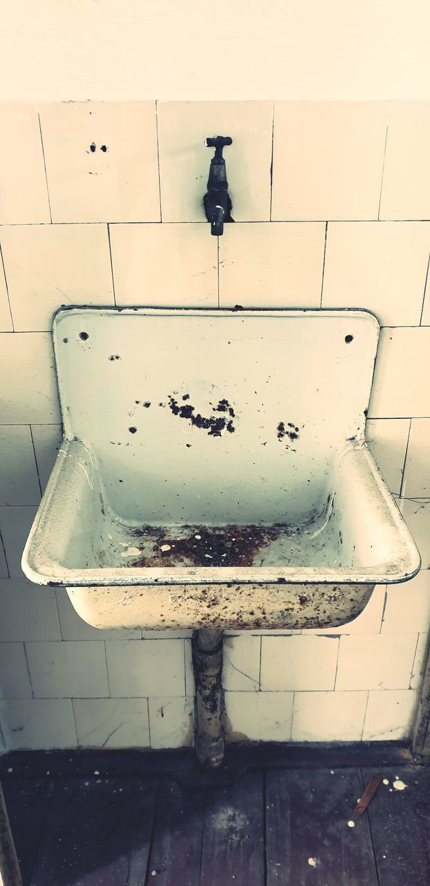 abandoned, old, household equipment, obsolete, bathroom, sink, deterioration, decline, run-down, indoors, damaged, rusty, domestic room, no people, messy, dirty, dirt, domestic bathroom, tile, wall - building feature, tiled floor