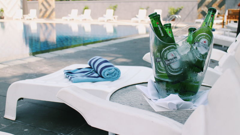 Absence Blue Close-up Day Empty Focus On Foreground Furniture Green Color Growth The Essence Of Summer No People Plant Seat Side By Side White Relax Pool Side Poolside Water Ice Bucket Chill Beverage Alcoholic Drink Beer Beers