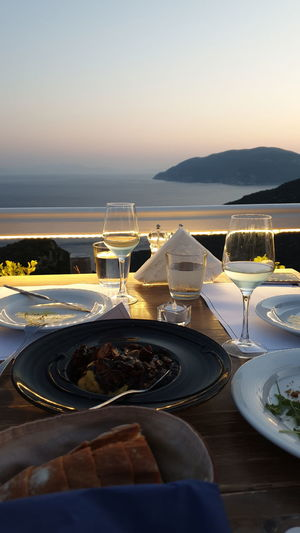 High angle view of food on table at restaurant against sky during sunset