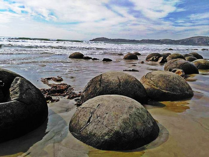 The Moeraki Boulders are a group of very large spherical stones on Koekohe beach. Water Beach Sea No People Rock - Object Cloud - Sky Day Nature Tranquility Sky Outdoors Scenics Beauty In Nature Horizon Over Water