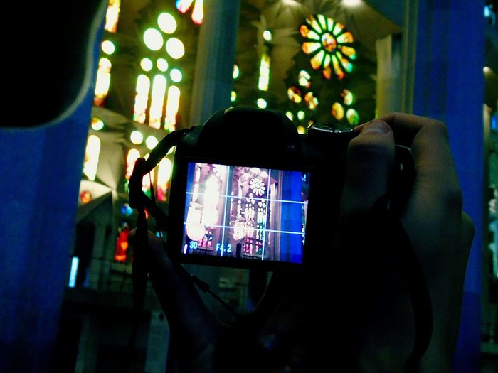 Wireless Technology Technology Multi Colored Human Hand Indoors  Lifestyles One Person Holding People Close-up Men Illuminated Sagrada Familia Bacelona Inside Sagrada Familia