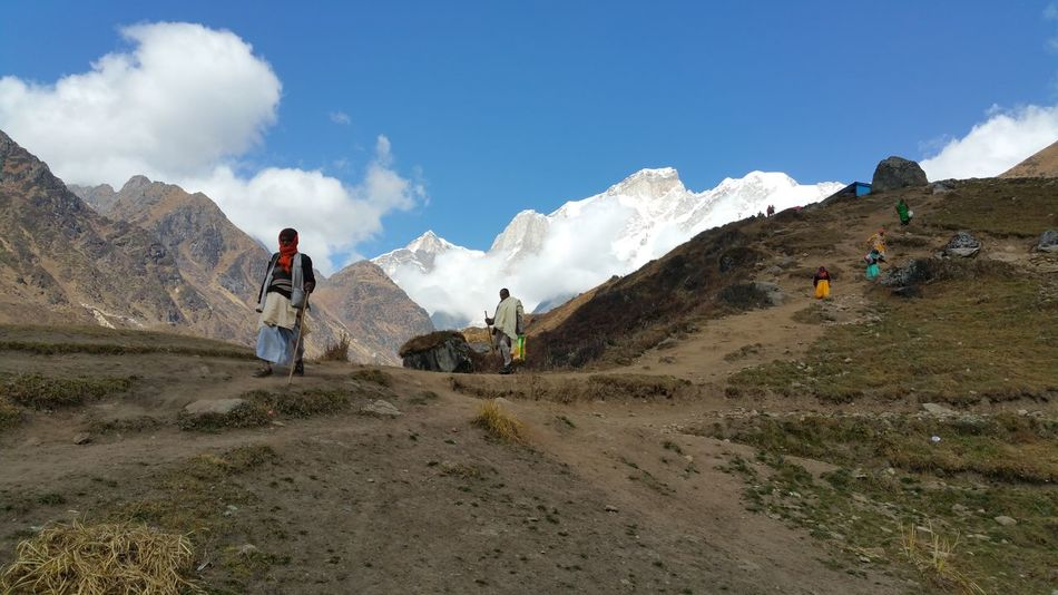 Trek route in Himalayas. Himalayas, India India, Men Mountain Full Length Spraying Standing Motion Sky Cloud - Sky Mountain Range Rocky Mountains Snowcapped Mountain Rugged Snowcapped Hiker Mountain Peak Physical Geography
