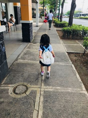 on the go Real People Child Childhood Full Length Lifestyles Women Autumn Mood Leisure Activity Boys Females Day Girls Men Casual Clothing People Males  Rear View Incidental People Footpath Walking Outdoors
