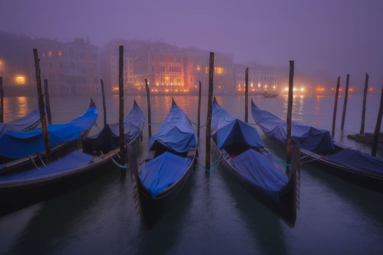 Gondolas Moored At Sea During Foggy Weather