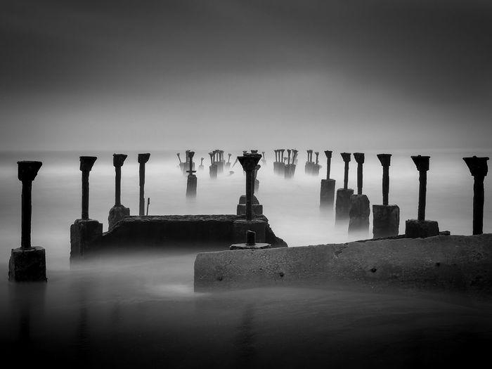 Broken pier in sea against sky in calicut city