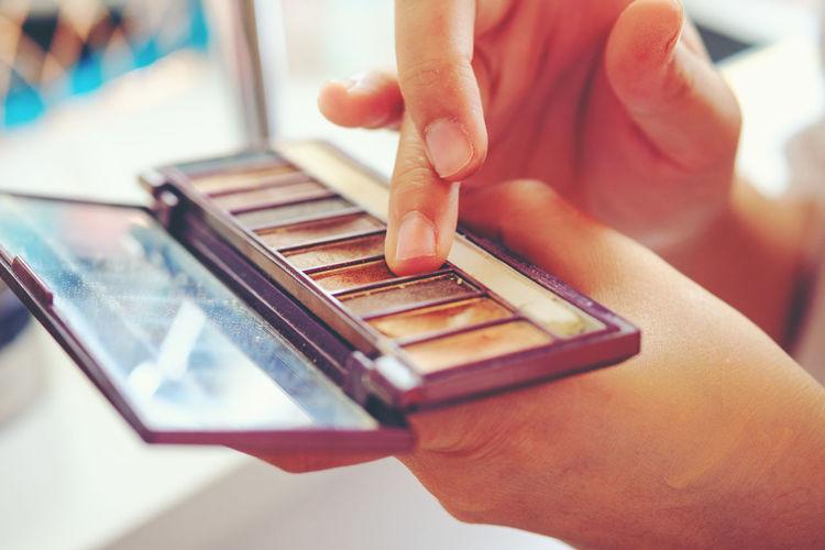 Close-up of woman applying make up