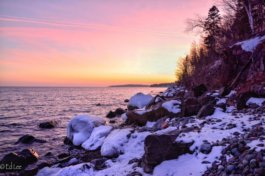 Sunset on the shore Sunset Nature Sea Beauty In Nature Scenics Tranquil Scene Tranquility Sky Water Orange Color Idyllic Horizon Over Water Cold Temperature Outdoors Malephotographerofthemonth Minnesota Lakesuperior Snow Day